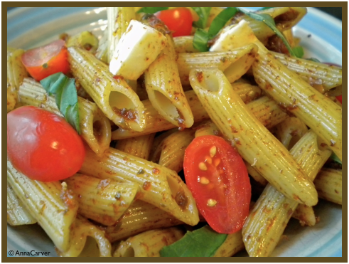 Penne with Sun Dried Tomato Dressing, Mozzarella, Tomatoes and Basil